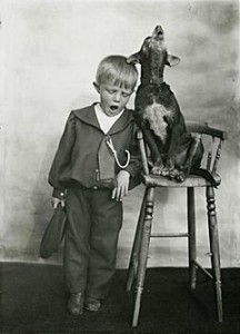 240px-Small_boy_with_a_pet_dog_singing_in_unison-216x300
